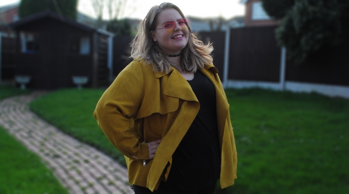 Plus size yellow jacket seen modeled by plus size girl