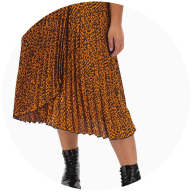 Plus size woman wearing orange animal print midi skirt with military boots
