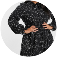 Woman wearing button down black and white spot dress