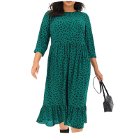 Woman wearing green leopard print smock dress
